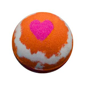 Round bath bomb colored with swirls of bright orange and white. There is a magenta heart on the top against the orange.