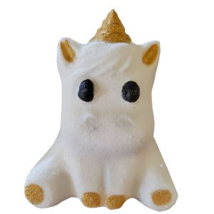 Sitting chubby unicorn shaped bath bomb. It is pure white with black painted eyes. The horn, inner ears, and four feet have shimmery golden hooves painted on.