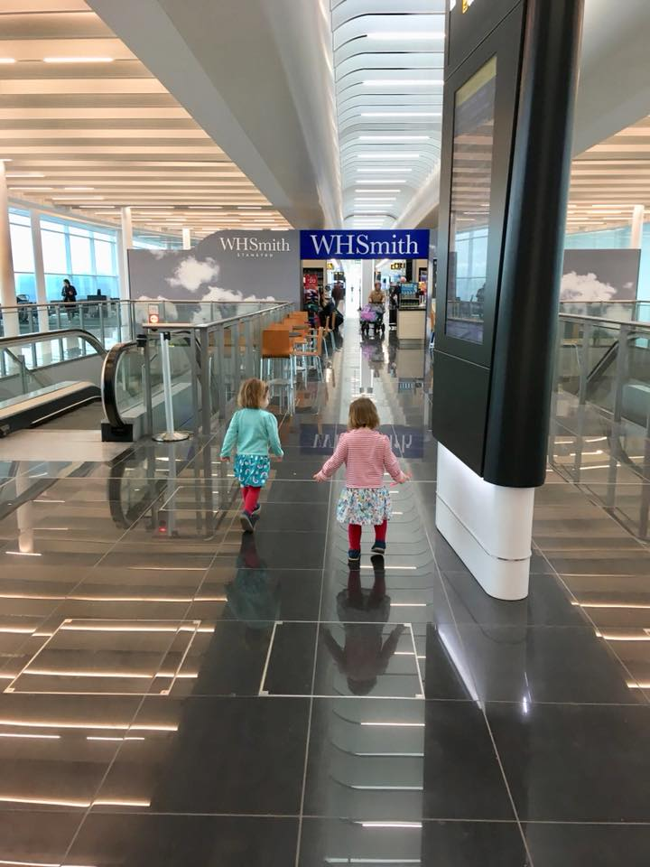 twins running off some energy in the airport