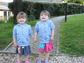 Twins, Poppy and Tabitha smiling at Greenwood Grange