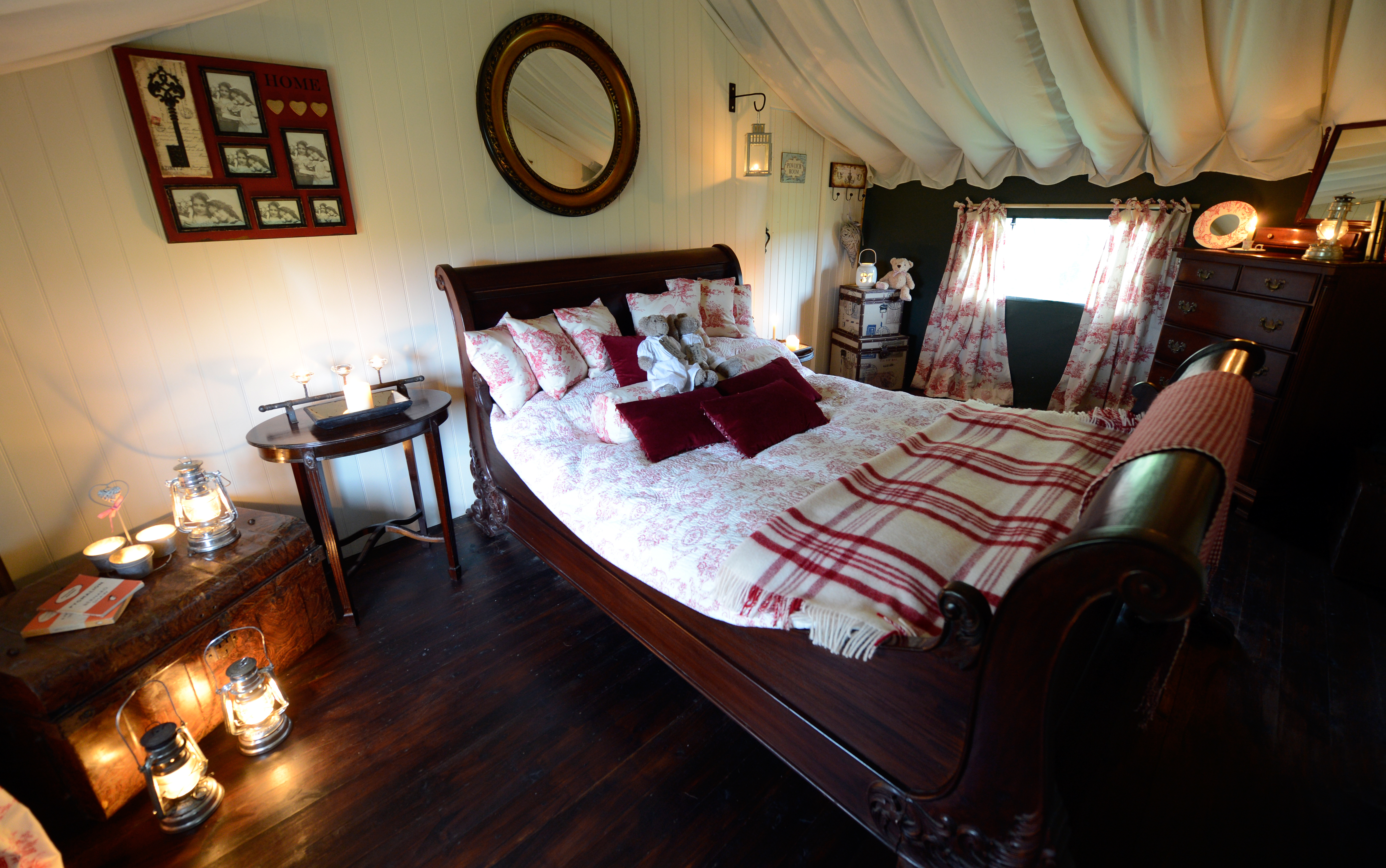 The bedroom at the Dandelion Hideaway showing the wooden bed