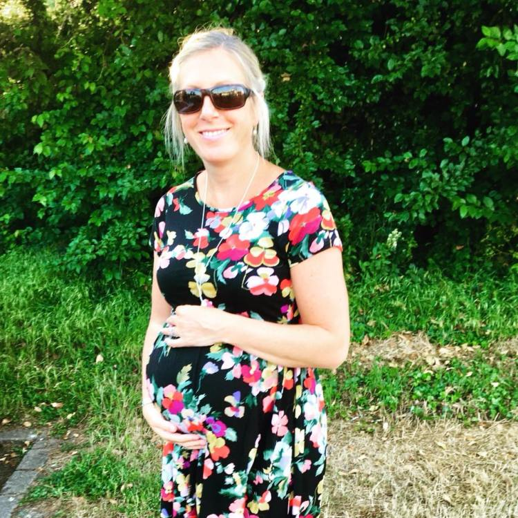 Mummy posing with pregnant bump on holiday