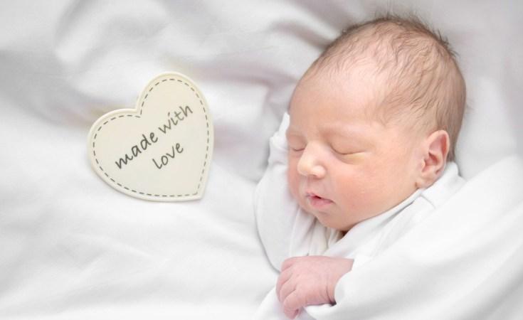 Newborn baby sleeping. Baby shower gift guide