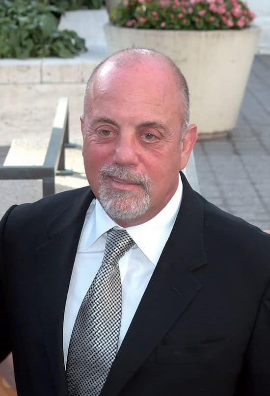 "<a href=""https://blog.shankbone.org"">David Shankbone</a>, <a href=""https://commons.wikimedia.org/wiki/File:Billy_Joel_4_Shankbone_Metropolitan_Opera_2009.jpg"">Billy Joel 4 Shankbone Metropolitan Opera 2009</a>, <a href=""https://creativecommons.org/licenses/by/3.0/legalcode"">CC BY 3.0</a>"