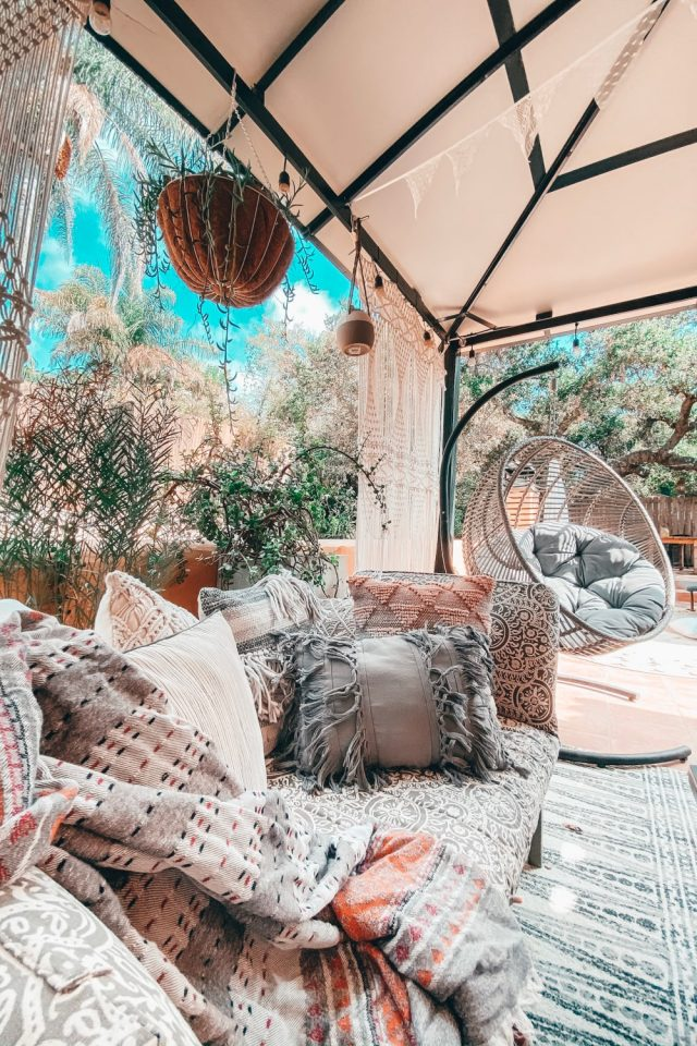 Cozy Fall Outdoor Rooms with blankets and plants | Poplolly co