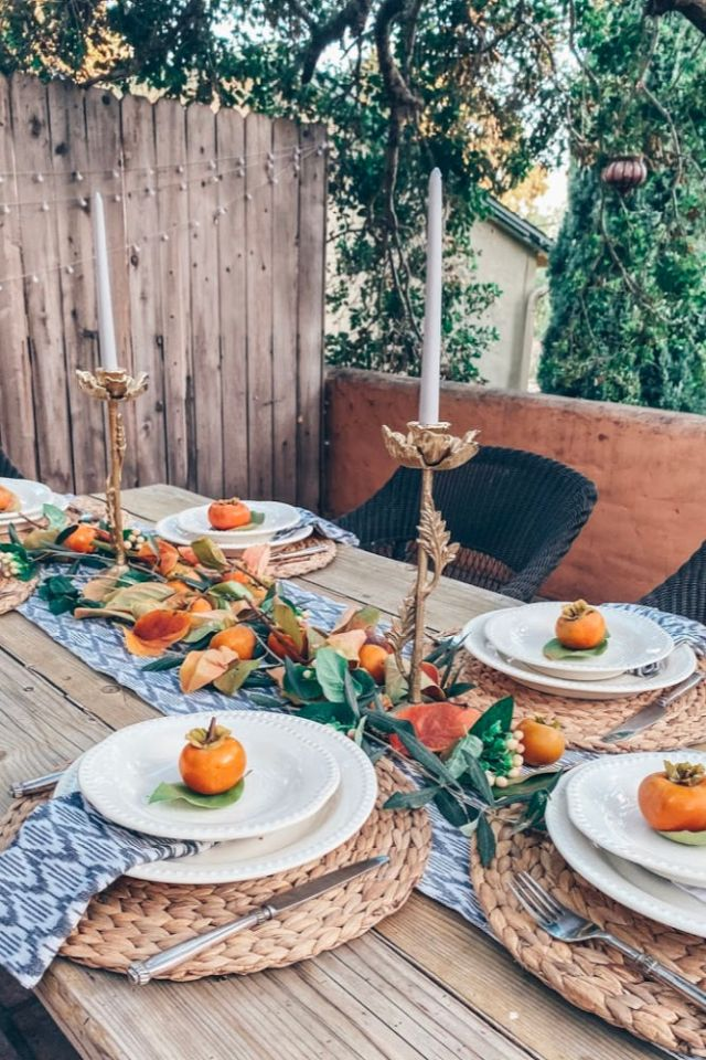 Thanksgiving tablescape using simple white dishes and persimmons and olive branches | Poplolly co