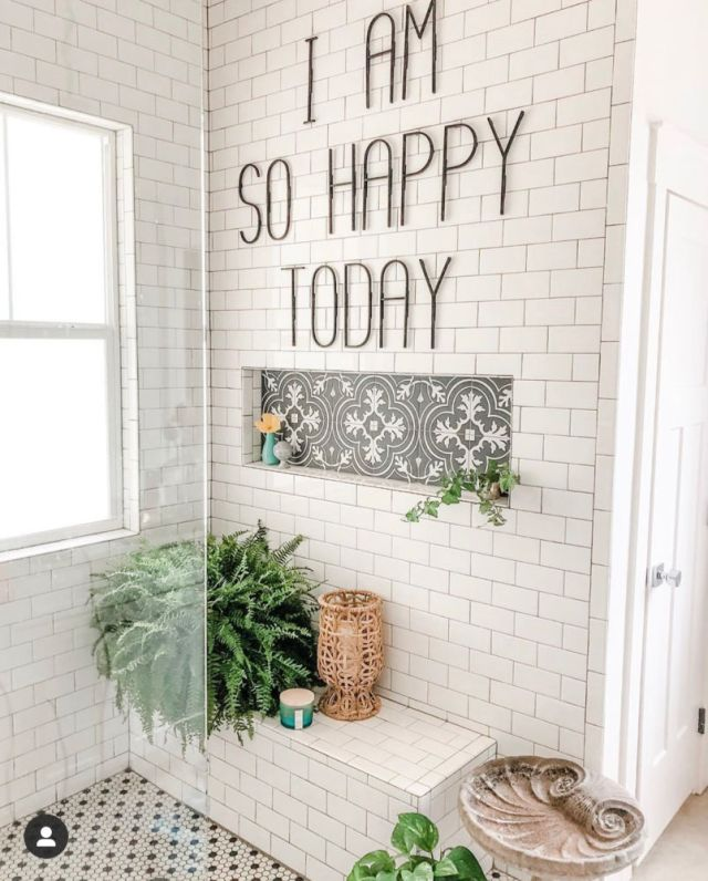 tiled shower with metal letters and plants | Poplolly co