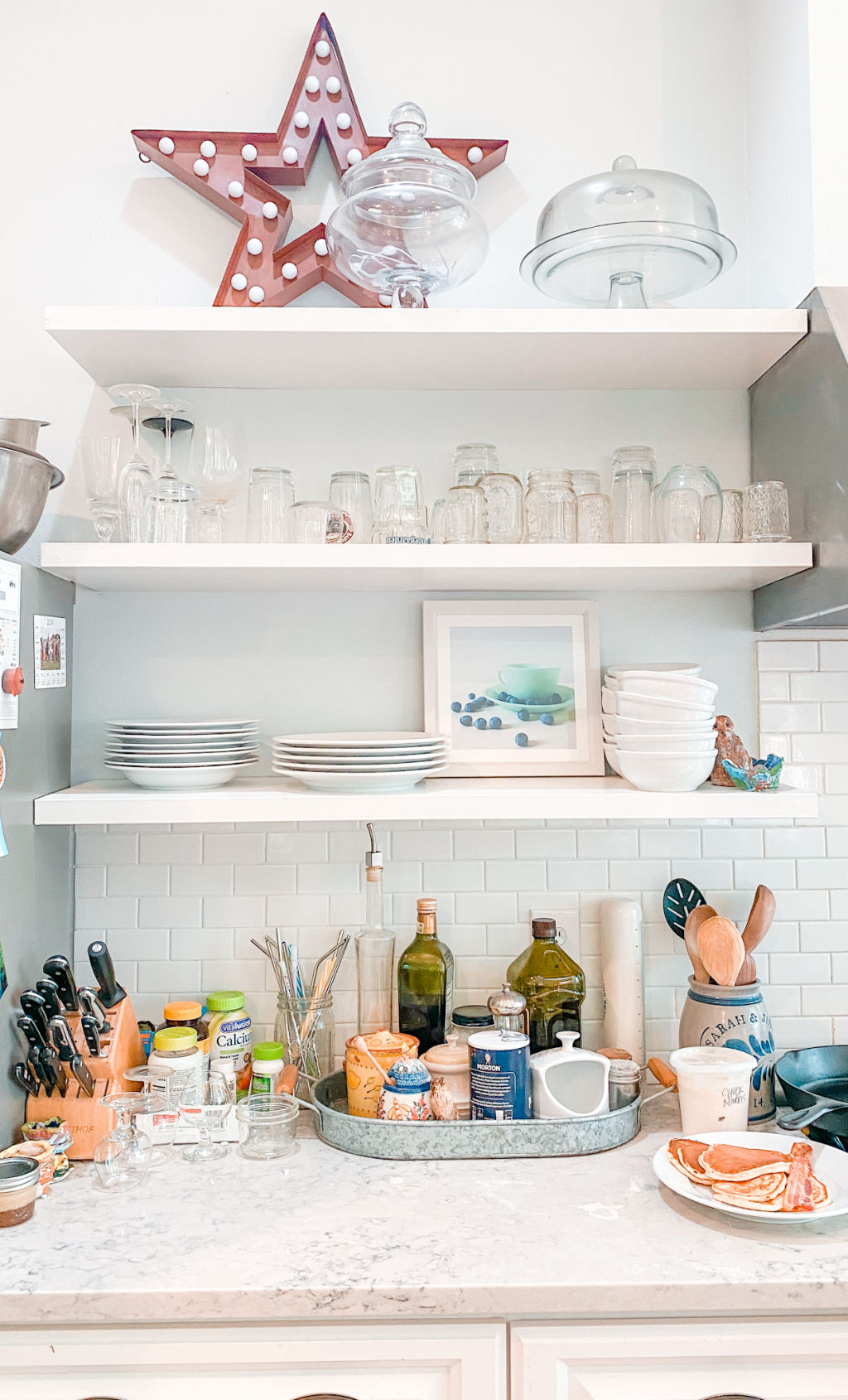 light bright white farmhouse kitchen in Bainbridge Island | open shelving | kitchen decor | shelf styling | Poplolly co