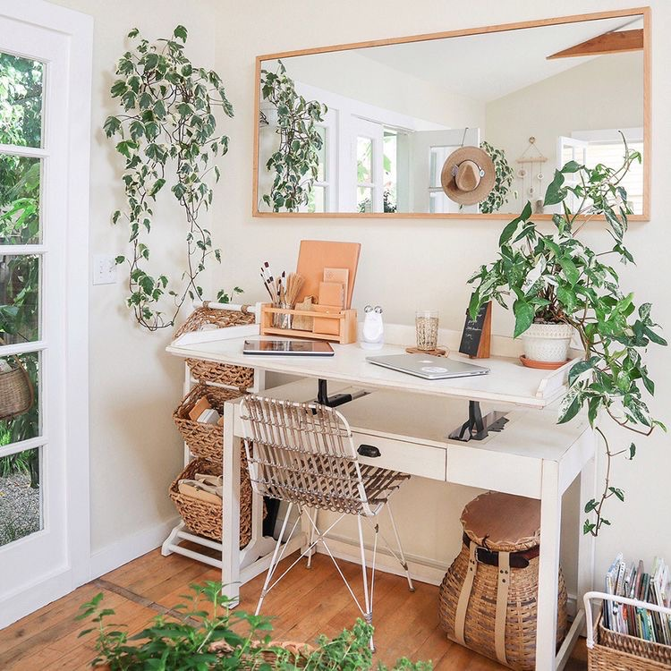 white sit to stand desk with mirror and lots of plants | Poplolly co