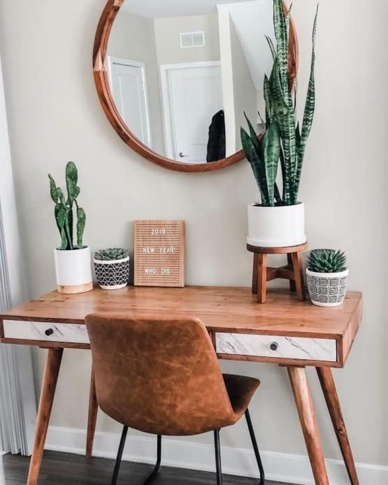 round wood mirror, leather chair, mid century modern desk, snake plant and succulents for a bohemian office | Poplolly co