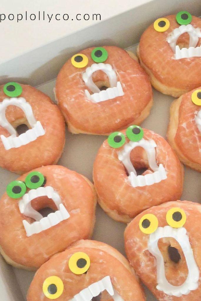 donuts with vampire teeth | #halloweentreats #halloweentreatsdesserts #halloweentreatsforkids #halloweentreatseasy #halloweentreatsdessertseasy | Poplolly co