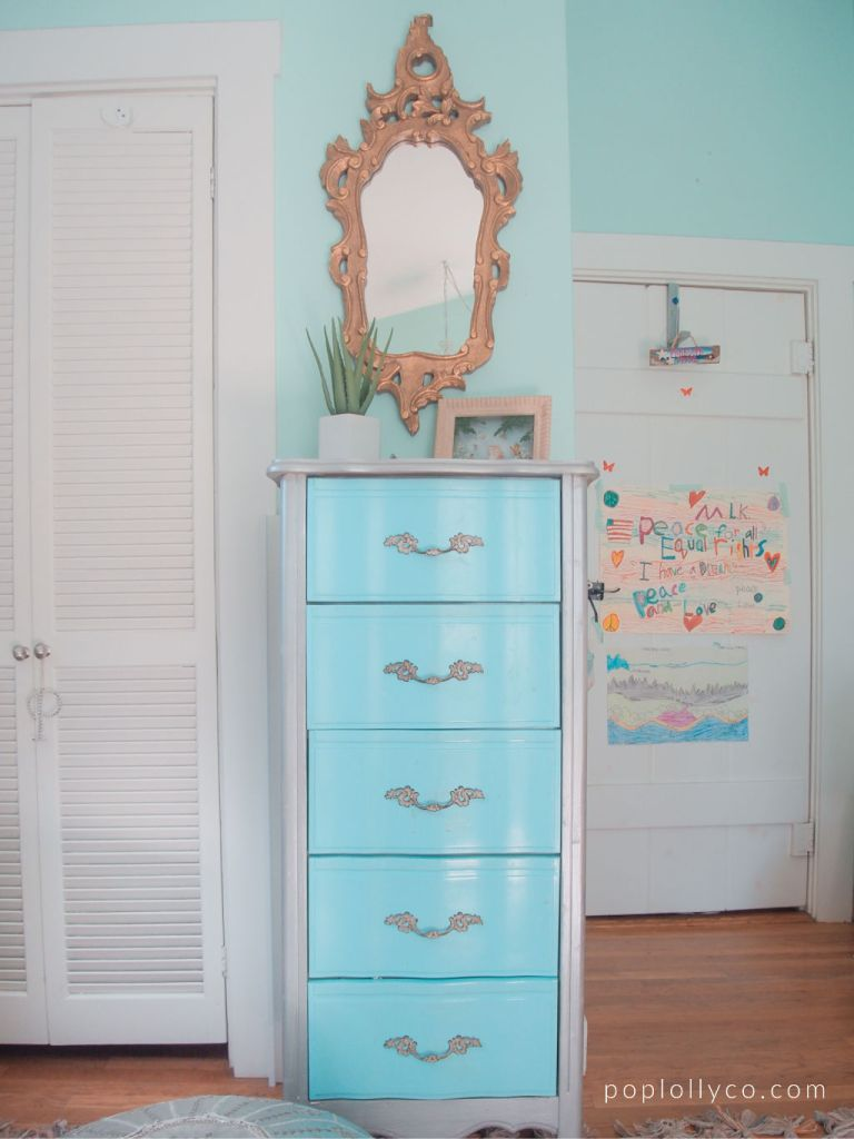 brass vintage mirror with turquoise metallic dresser for a bright boho girls bedroom | Poplolly co