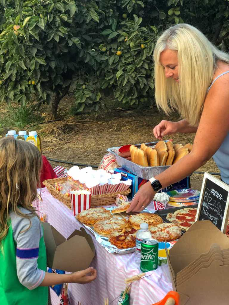 pizza and hot dog concession stand for an outdoor movie night birthday for kids | Poplolly co