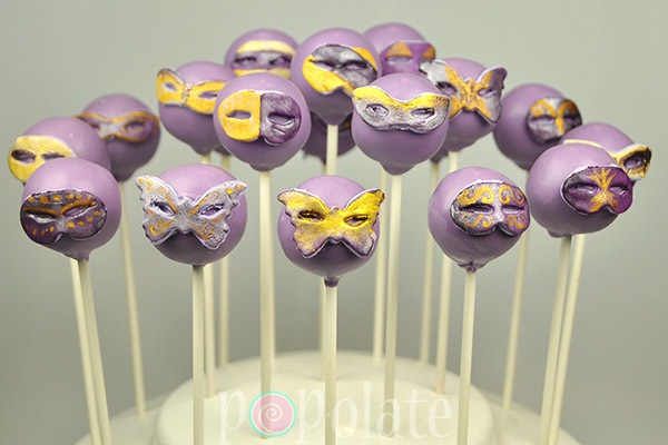 Gold and purple Masquerade masks cake pops