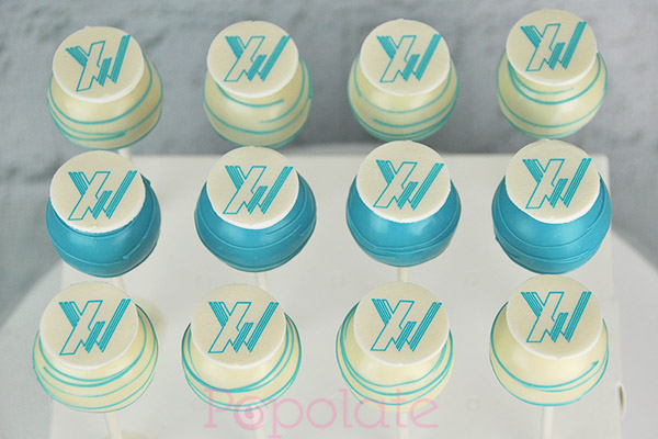 Xaxis cake pops corporate company logo