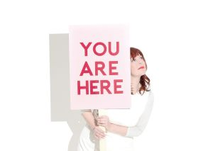 Piney Gir with You Are Here sign