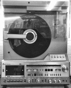 Vertical turntable and cassette machine - how we listen to music - CC BY 2.0