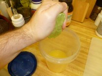Squeezing Limes Into Orange Juice
