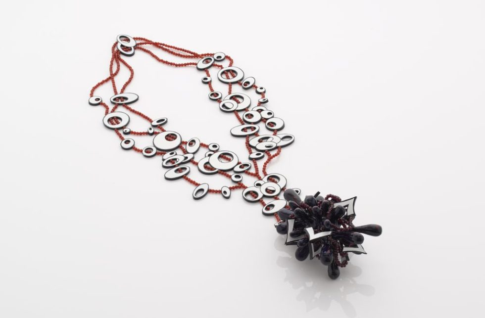 "Heavy Bassline (Stockholme Syndrome) Necklace : based on a fast drop D bassline in Muse song ""Stockholm Syndrome"". Airbrushed polymorph and composite board with garnet and carnelian beads."