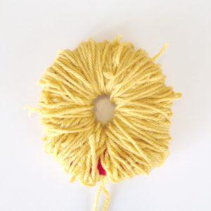 done winding all the Yarn | How to Make a Pom Pom Burger | Cool Pom Pom DIYs | Make a Pom Pom with Yarn from the Pop Shop America blog