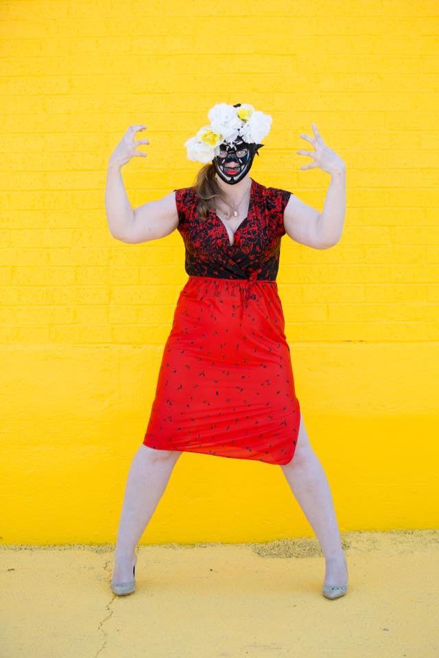 lady luchador yellow background fashion photo