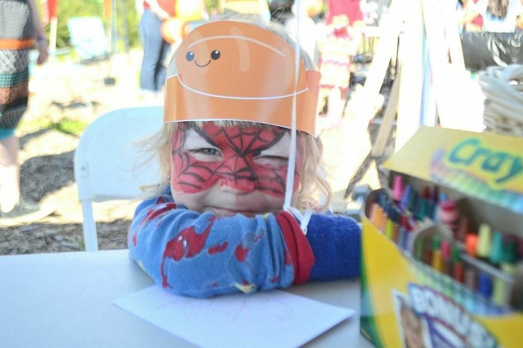 adorable kid wearing shrimp hat at shrimp fest houston