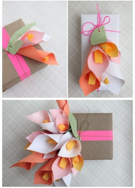 handcrafted lillies on top of gift wrapped packages