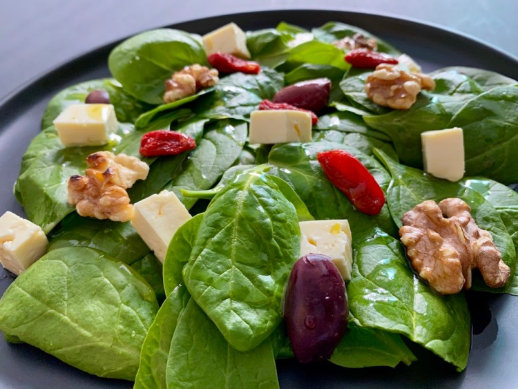 Baby spinach leaves salad with feta cheese and goji berries