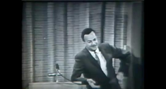 Richard Feynman giving a lecture on The Distinction of Past and Future. via YouTube.