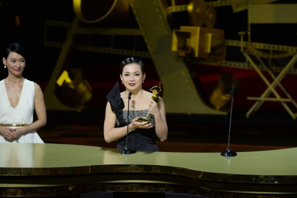 Yeo Yann Yann chokes up as she receives the Best Supporting Actress award for her performance in Ilo Ilo