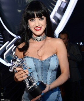 Big title: The busty singer was grinning with glee after receiving her trophy