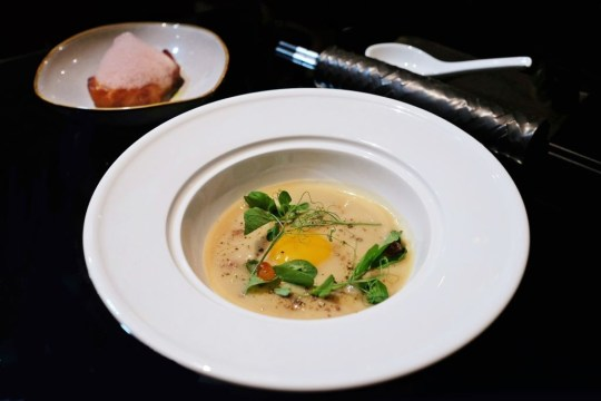 Elevated fish congee with sea bass and ginger espuma