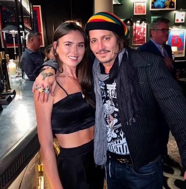 Depp with fan in London pub