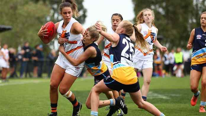 Girls playing Aussie Rules (AFL)