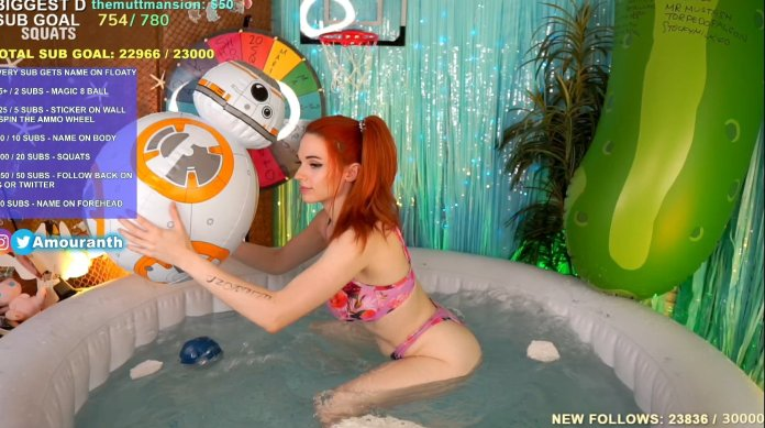 Amouranth doing squats in hot tub