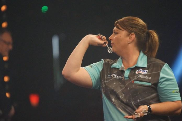 Corine Hammond playing darts.