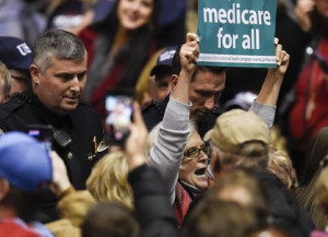 Carol Paris protesting for Medicare at Trump rally in Tennessee March 2017