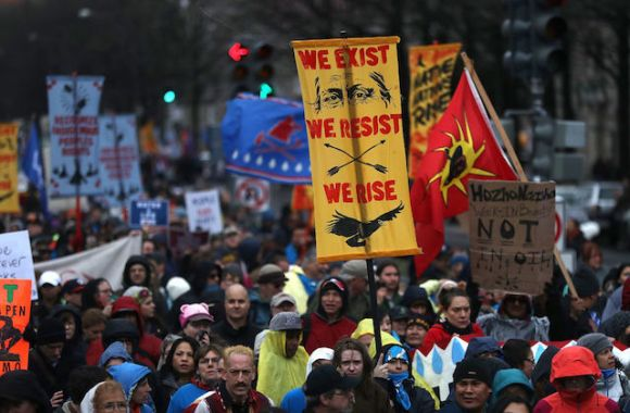 Protesters march during a demonstration against the Dakota Access Pipeline on March 10, 2017 in Washington D.C. Thousands of protesters and members of Native nations marched in Washington D.C. to oppose the construction of the proposed 1,172 Dakota Access Pipeline that runs within a half-mile of the Standing Rock Sioux reservation in North Dakota.  Photo: Justin Sullivan/Getty Images