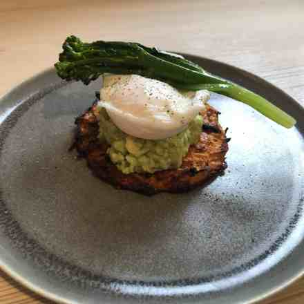 Sweet Potato rosti with guacamole and poached egg and a stem of brocollini