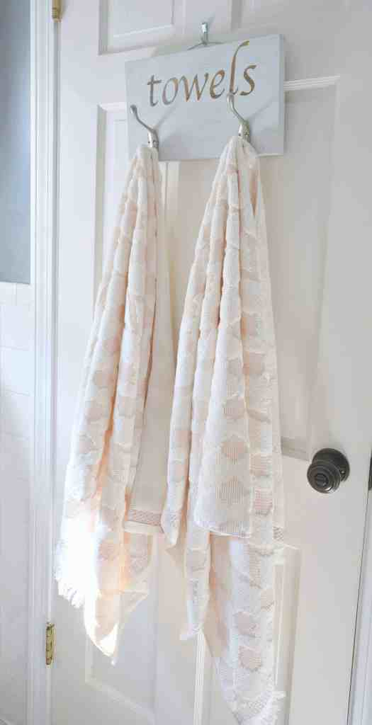This DIY towel rack is the finishing touch on this master bathroom refresh
