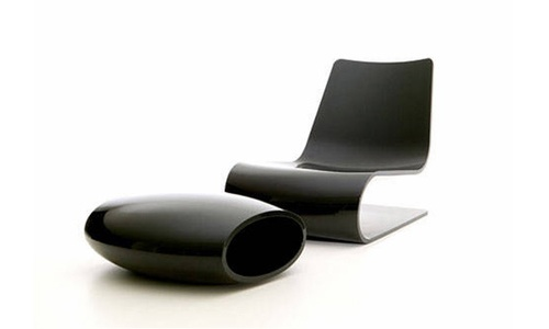 Minimalist Chair And Ottoman At Evinco