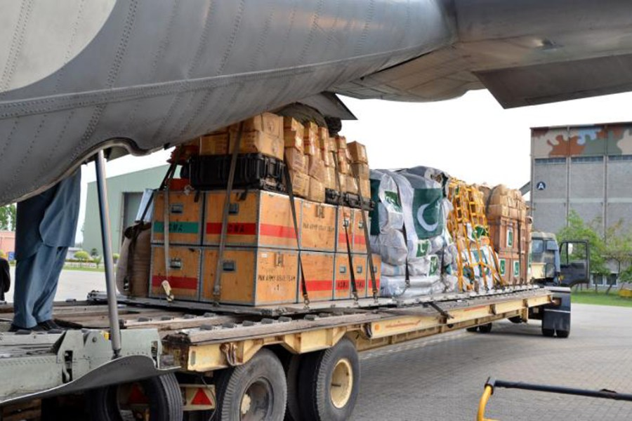 Pakistani soldiers load boxes of aid and supplies for earthquake victims in Nepal in this image taken April 26 and released by Inter Services Public Relations.