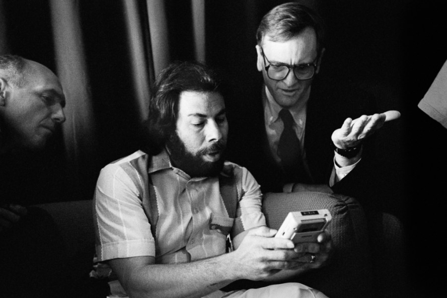 Apple Computer co-founder Steve Wozniak (left) and John Sculley (right), who joined Apple in 1983 as president and CEO looking at the original Game Boy, San Francisco, Ca., 1991.