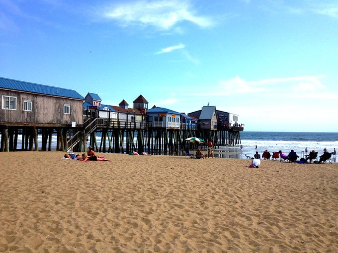 Mainers on the beach at Old Orchard Beach's pier.