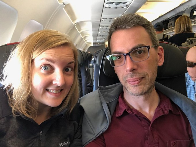 a selfie of me and jason aboard our plane, ready for takeoff