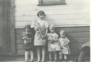 Grandma and her cousins with their dolls. Grandma is the tallest.