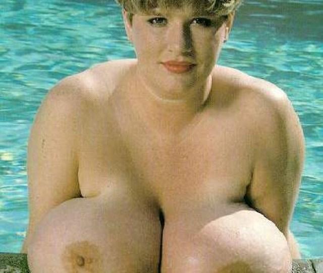 Big Floppy Tits Sitting By The Pool