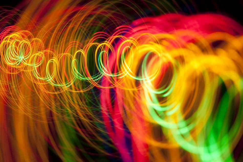 a spiral of vividly coloured lines of light on a black background