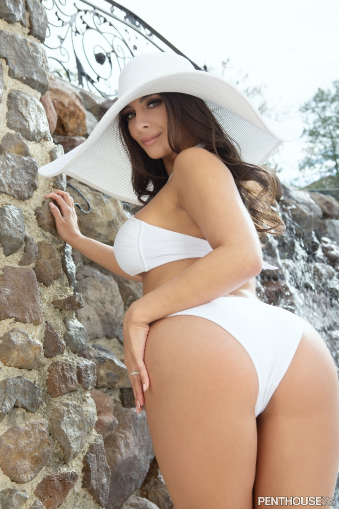 Tru Kait outdoors poolside in her May 2021 Penthouse Pet Of The Month photo spread 001