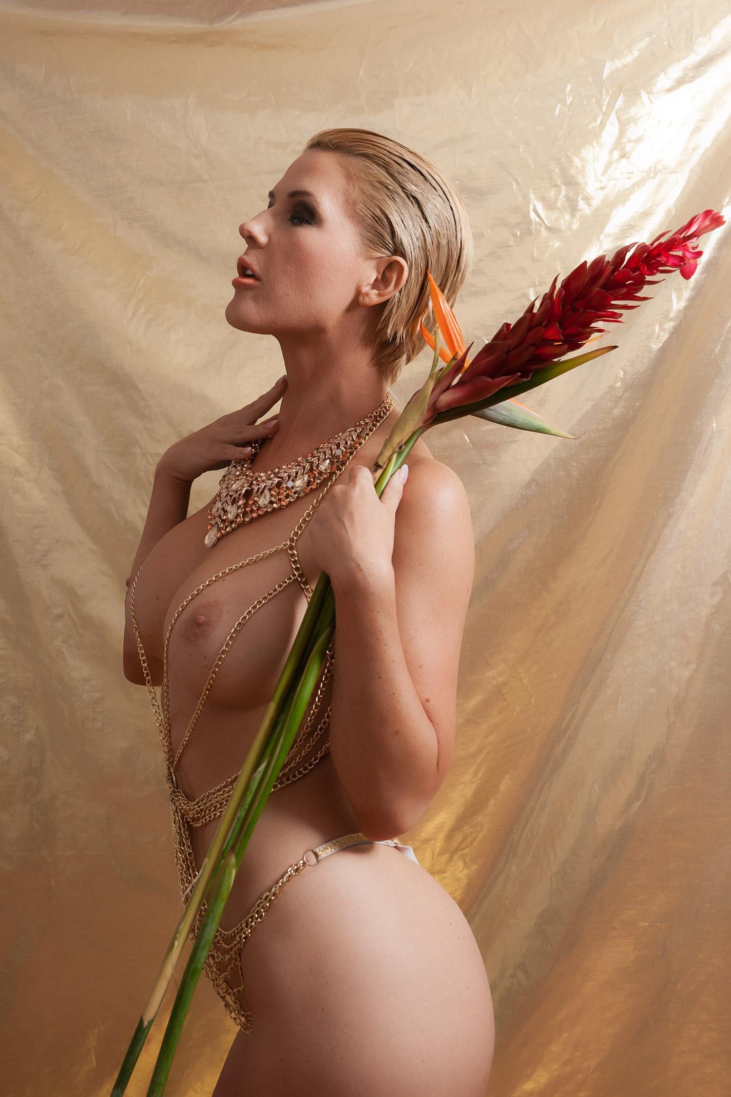 Micro Gold String Bikini nude girl holding ginger flower